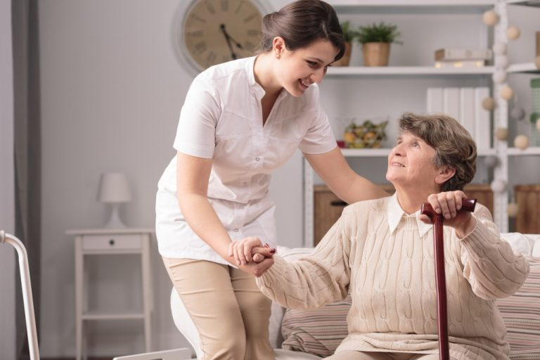 Elderly woman with her nurse
