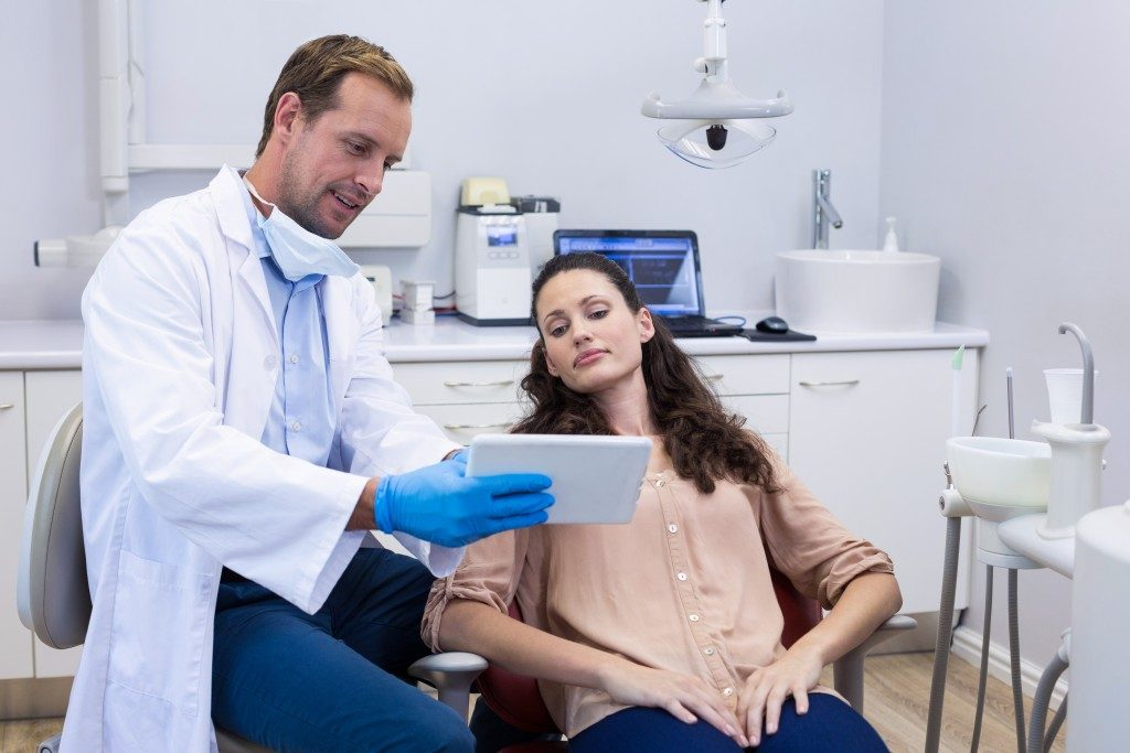 Patient on dental chair with dentist