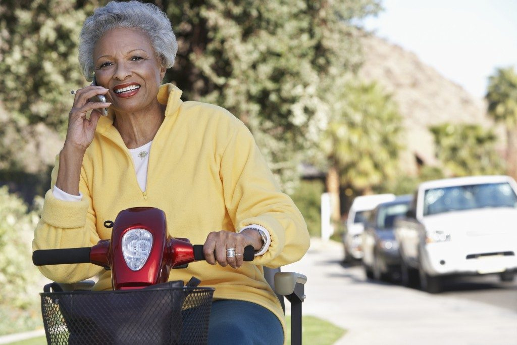 Elderly woman using a mobility aid