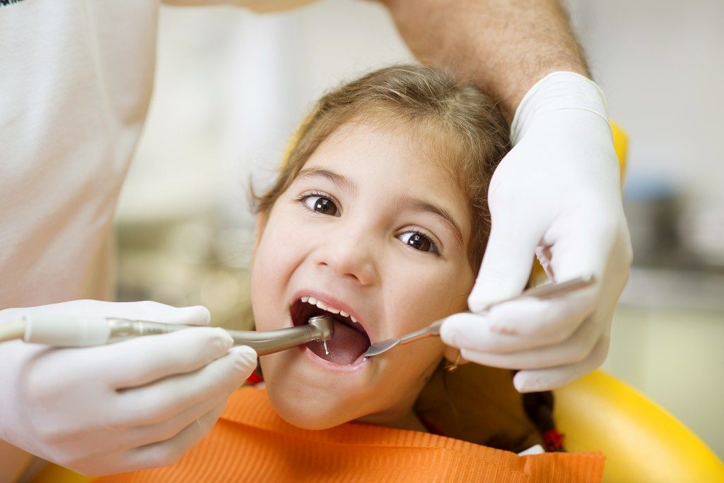 Little girl having a dentist appointment