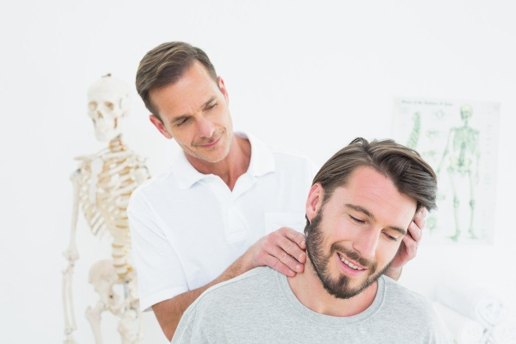 Smiling man at a chiropractic session