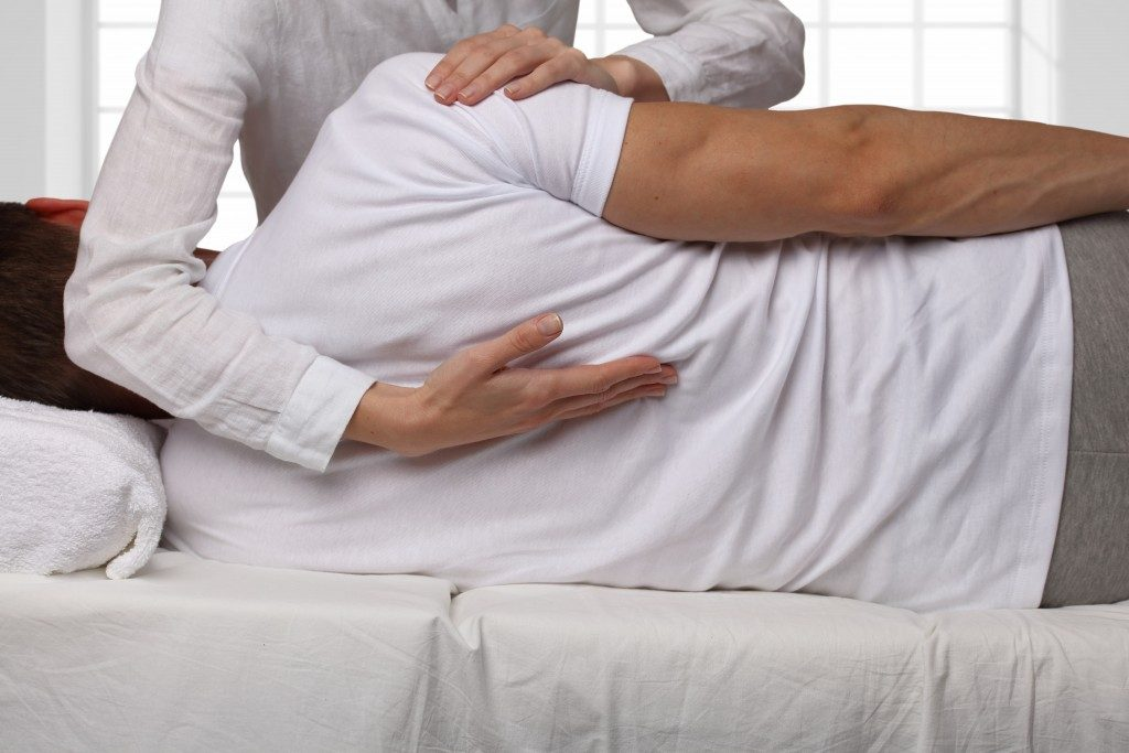 Man having a chiropractic back adjustment
