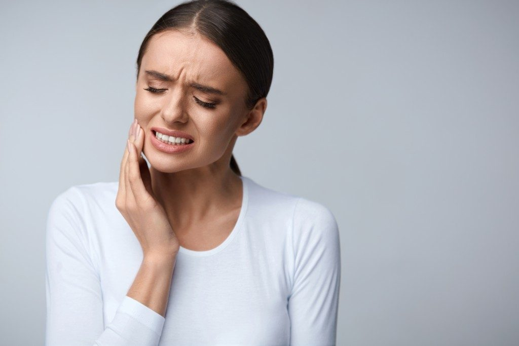 woman suffering from tooth ache