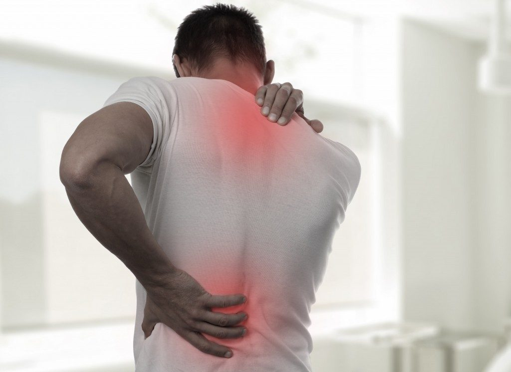 man suffering from back pain