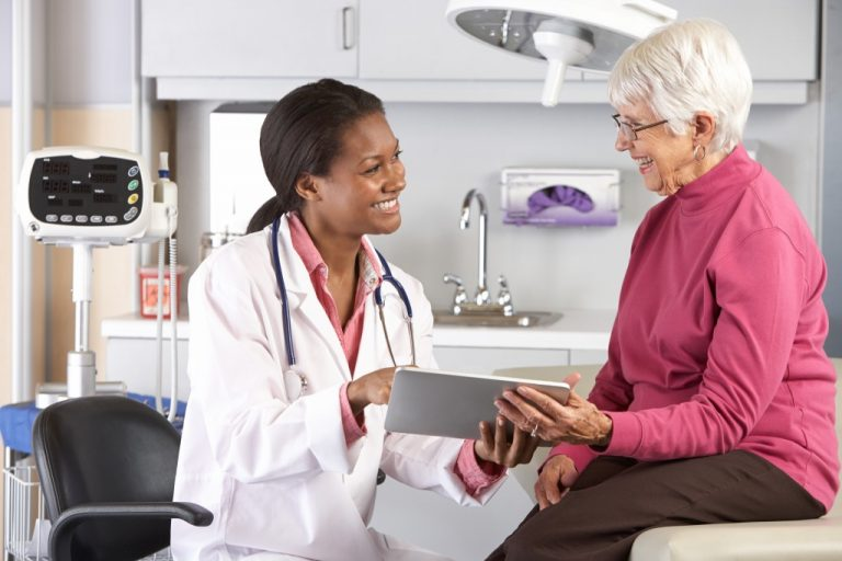 older woman talking to a doctor
