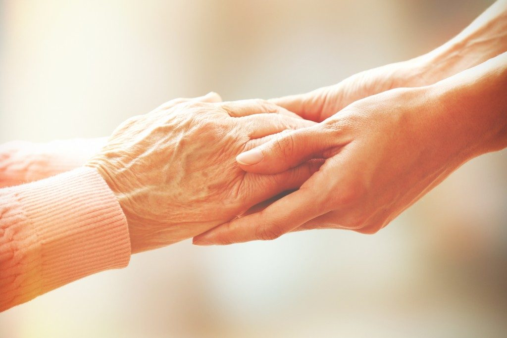 Helping hands of elderly person