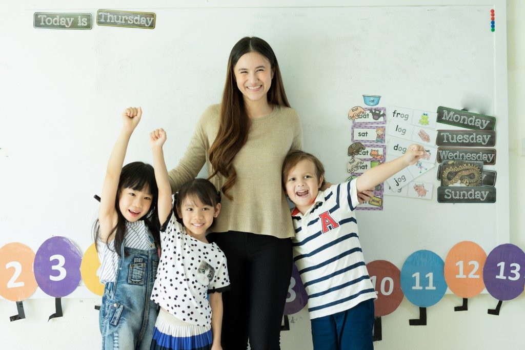teacher with kids inside the classroom