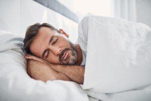 Man sleeping sideways