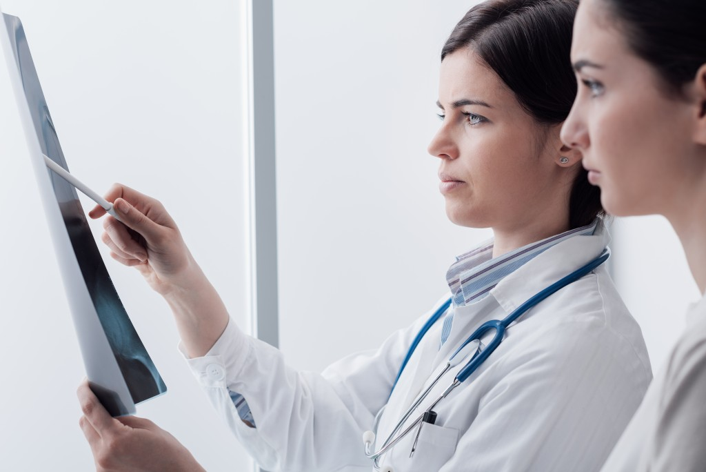doctor examining xray results