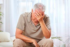 old man feeling sad
