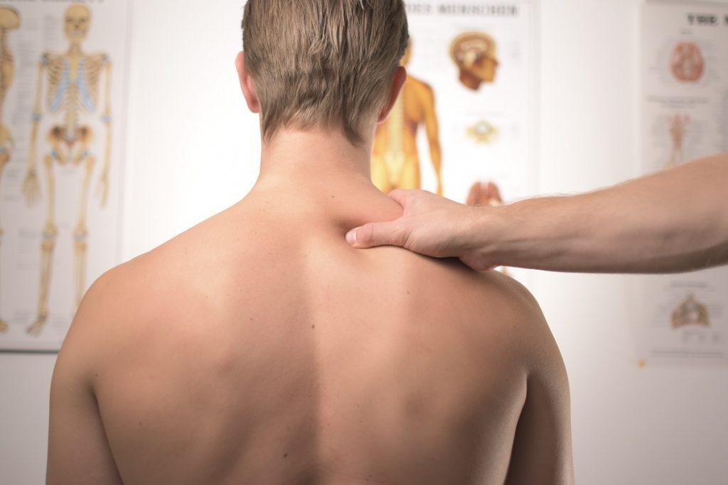 Man suffering from stiff neck