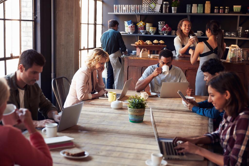 People working in coffee shop