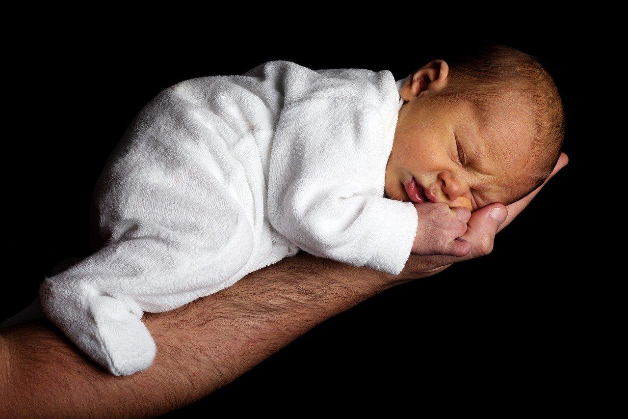 newborn being carried