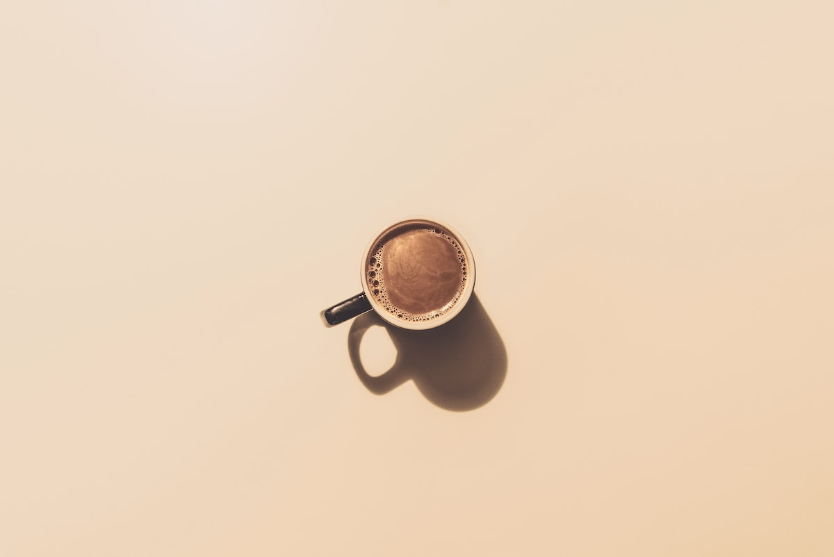 cup of coffee on beige background