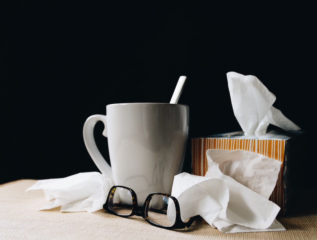 tissues, glasses, and a cup of tea